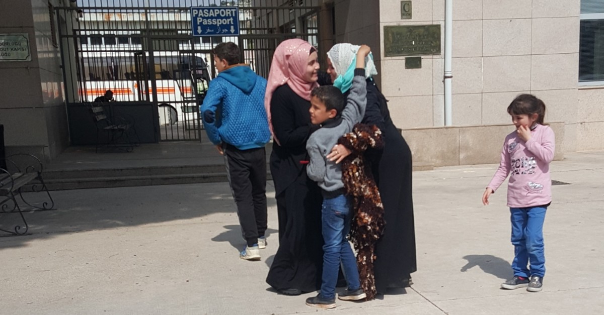 Fatima Badawi hugs her children after being reunited with them at the Cilvegu00f6zu00fc border crossing between Turkey and Syria, three years after they were separated, April 10, 2019.