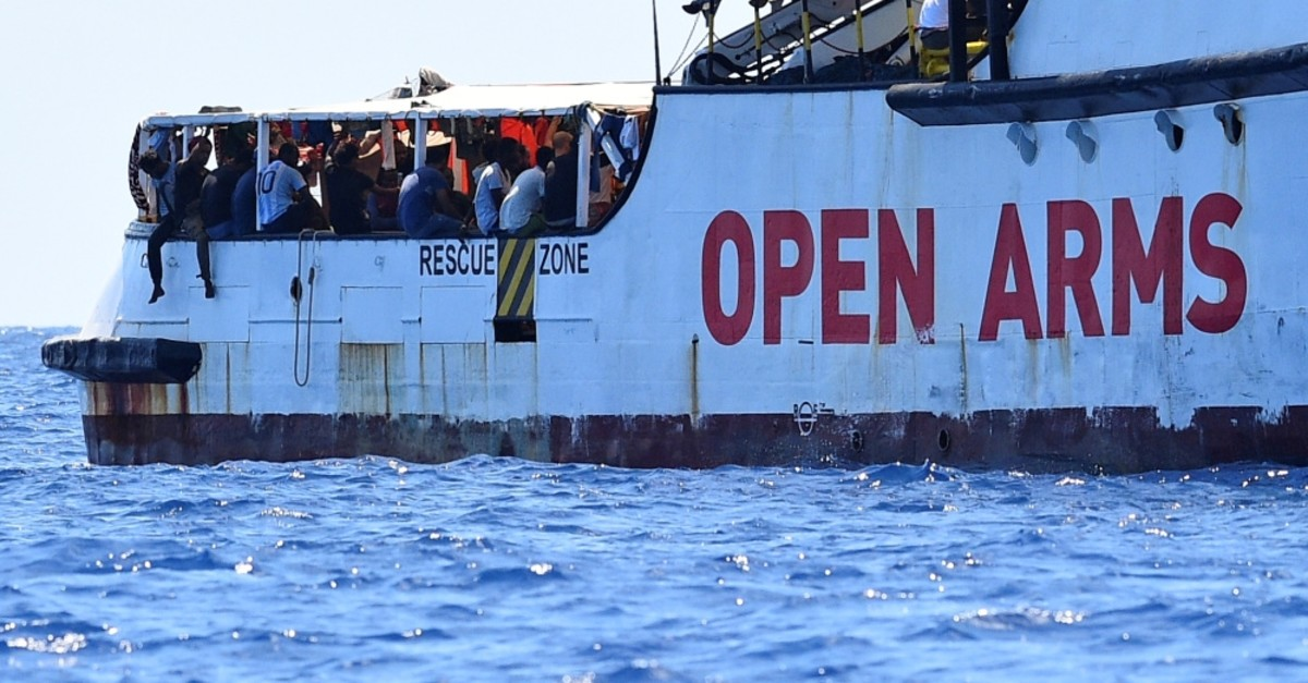 Migrants aboard the Spanish rescue ship Open Arms, close to the Italian shore, Lampedusa, Aug. 16, 2019.