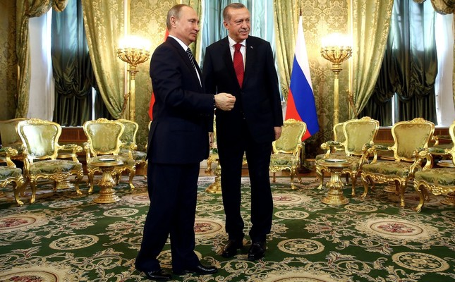 President Erdoğan and Russian President Putin shake hands during a meeting in the Kremlin on bilateral relations and the Syrian crisis, March 10, 2018.