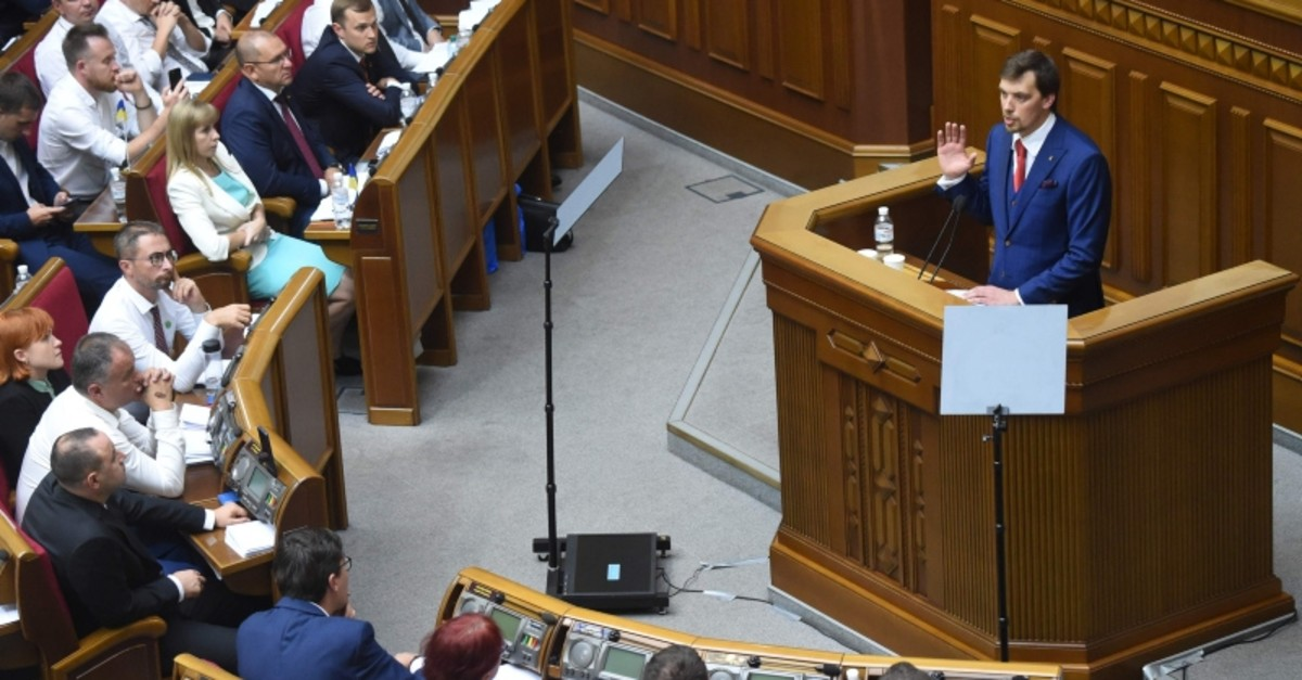 Ukraine's MP Oleksiy Goncharuk (R) speaks during the first session of the new parliament, in Kyiv, on Aug. 29, 2019 (AFP Photo)