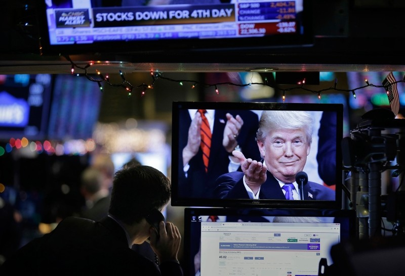 A picture of President Donald Trump is displayed on a computer on the floor of the New York Stock Exchange in New York, Monday, Dec. 24, 2018. (AP Photo)