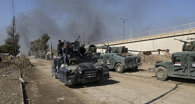 آليات عسكرية عراقية أثناء تقدمها غربي الموصل 06/03 2017   اسوشيتد برس