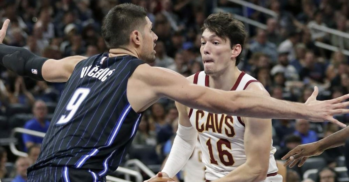 Cedi Osman (right) looks for a way around Orlando Magic's Nikola Vucevic during the second half of an NBA basketball game, Orlando, Oct. 23, 2019. (AP Photo)