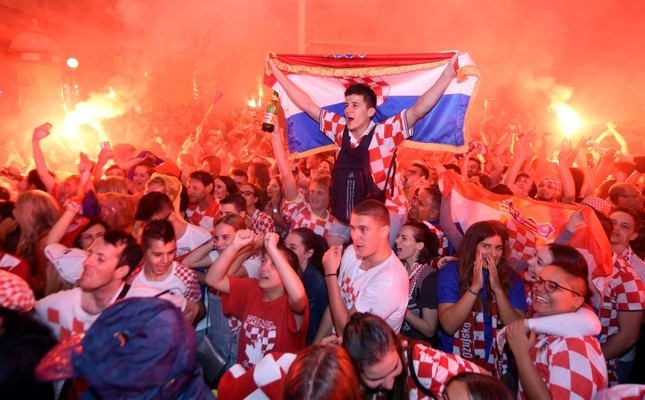 Croatian fans cheer while watching the semifinal match between Croatia and England at the 2018 soccer World Cup, in Zagreb, Croatia, Wednesday, July 11, 2018. (AP Photo)