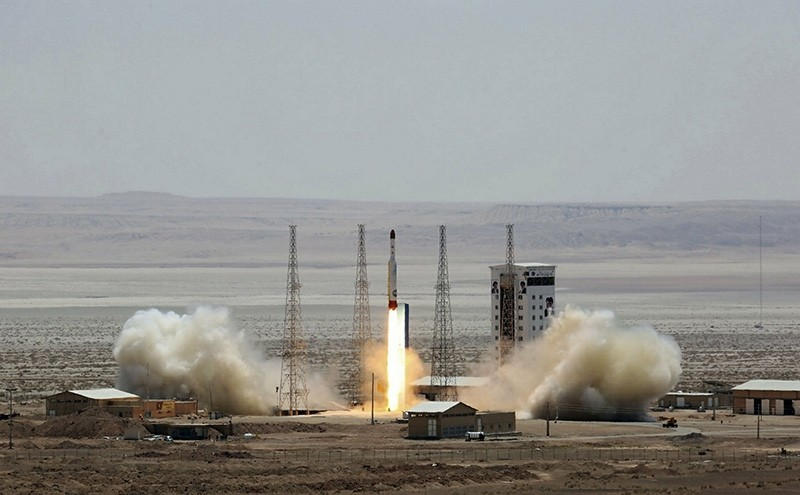 This July 26, 2017, file photo shows a handout photo released by Iranu2019s Defense Ministry showing a simorgh (phoenix) satellite rocket at its launch stie at an undisclosed location in Iran. (AFP Photo)