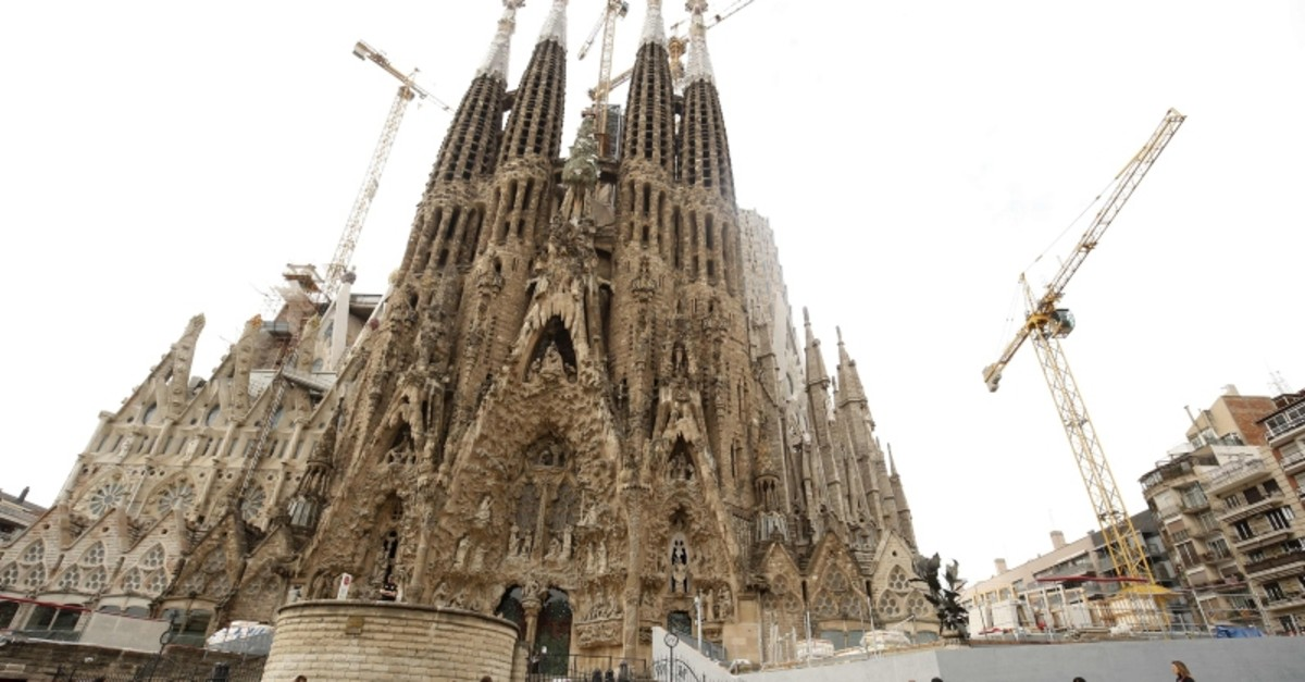 In this file photo taken on October 3, 2017 tourists stand outside the Sagrada Familia in Barcelona. (AFP Photo)