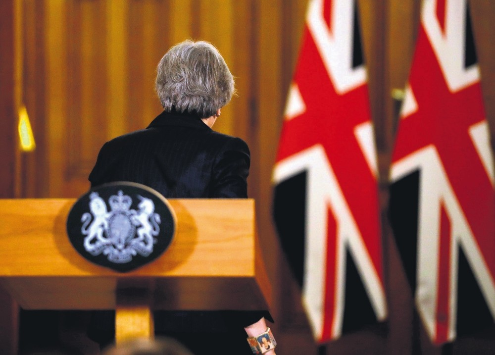 U.K. Prime Minister Theresa May leaves the podium after giving a press conference in central London about the Brexit process, Nov. 15.