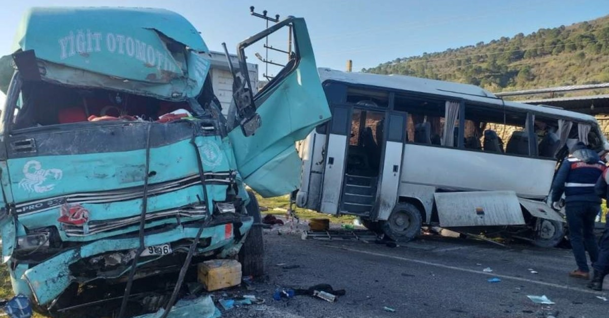 Wreckage of damaged truck and shuttle minibus are seen after an accident in Bergama district, Izmir, on Feb. 13, 2020. (DHA Photo)