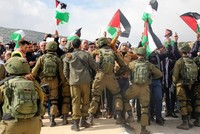 Israeli forces injure Palestinians during protests against US plan