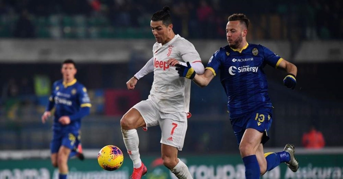 Juventus' Cristiano Ronaldo (L) fights for the ball with Verona's defender Amir Rrahmani, Verona, Feb. 8, 2020. (AFP Photo)
