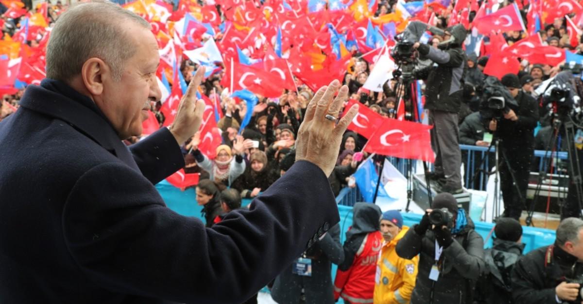 President Recep Tayyip Erdou011fan greets people at a meeting in eastern Turkey's Erzurum, Feb. 28, 2019.