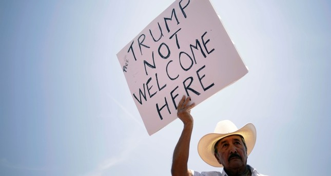 A man takes part in a rally against the visit of the U.S. President Donald Trump after a mass shooting at a Walmart store, in El Paso, Texas, U.S., August 7, 2019. (Reueters Photo)