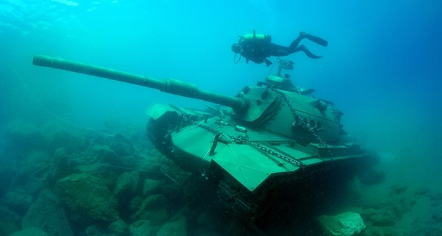 Model tank submerged underwater for tourist dive