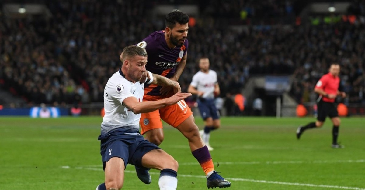 Toby Alderweireld of Tottenham and Sergio Aguero of Manchester City fight for the ball in a Premier League game, Oct. 29, 2018.