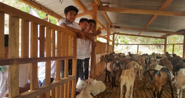 Locals at a pen for goats provided by TİKA in Mindanao. The agency also aims to boost agricultural income in the island.