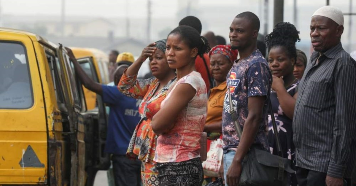 People are seen waiting for a bus at a bus stop, Lagos, Feb. 13, 2020. (REUTERS Photo)