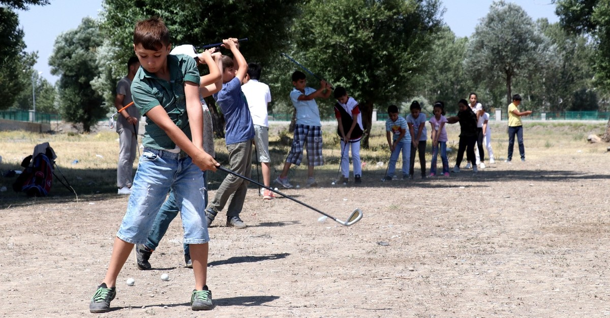 Young players practice in empty lots on uneven surfaces.