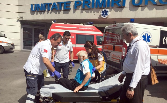 The medical team helps a Turkish man onto a stretcher as they prepare to transfer him from a Romanian hospital to Turkey.