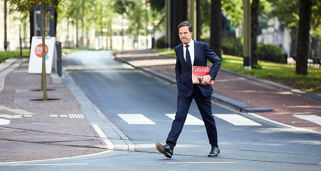 Dutch Prime Minister Mark Rutte arrives, after a short vacation, for the government formation talks at the Johan de Witthuis in The Hague, The Netherlands, Aug. 09, 2017. (EPA Photo)