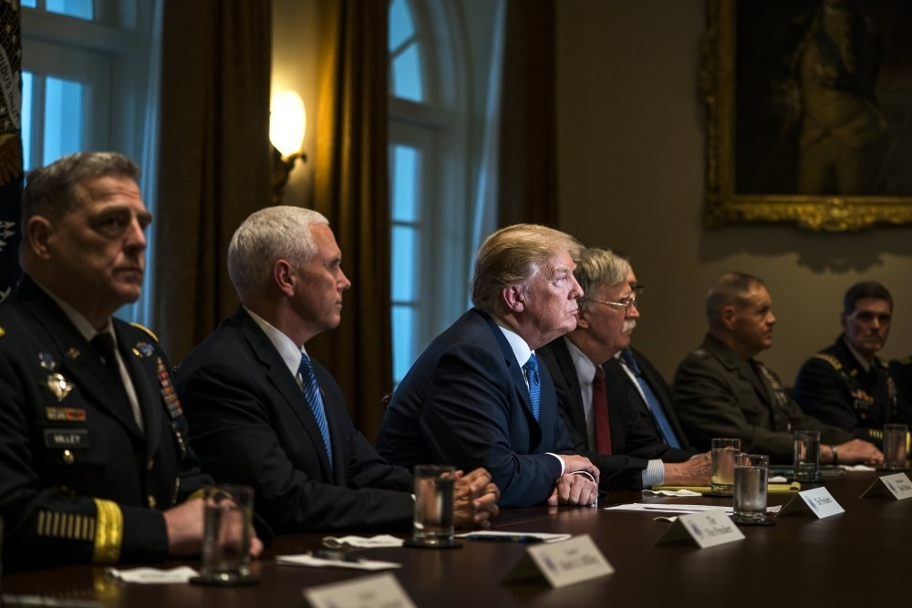 U.S. President Donald J. Trump (C) speaks with the media before a meeting with his military leadership in the Cabinet Room of the White House,  Washington, April 9, 2018.