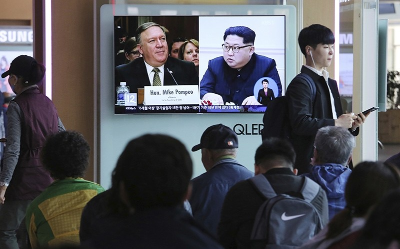 People watch a TV screen showing file footage of CIA Director Mike Pompeo, left, and North Korean leader Kim Jong Un during a news program at the Seoul Railway Station in Seoul, South Korea, Wednesday, April 18, 2018. (AP Photo)