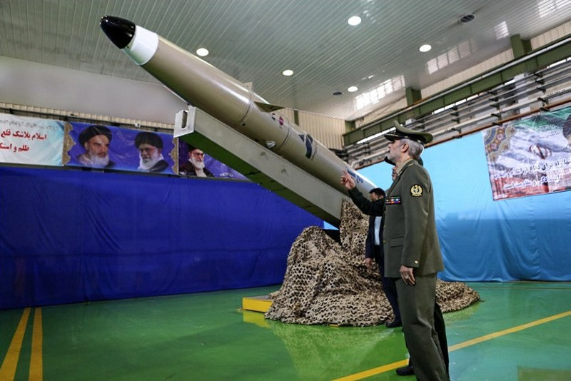 A handout picture released by Iran's Defence Ministry on August 13, 2018 shows Defence Minister, Brigadier General Amir Hatami, standing by the next generation short-range ballistic missile  ,Fateh Mobin., (AFP Photo)