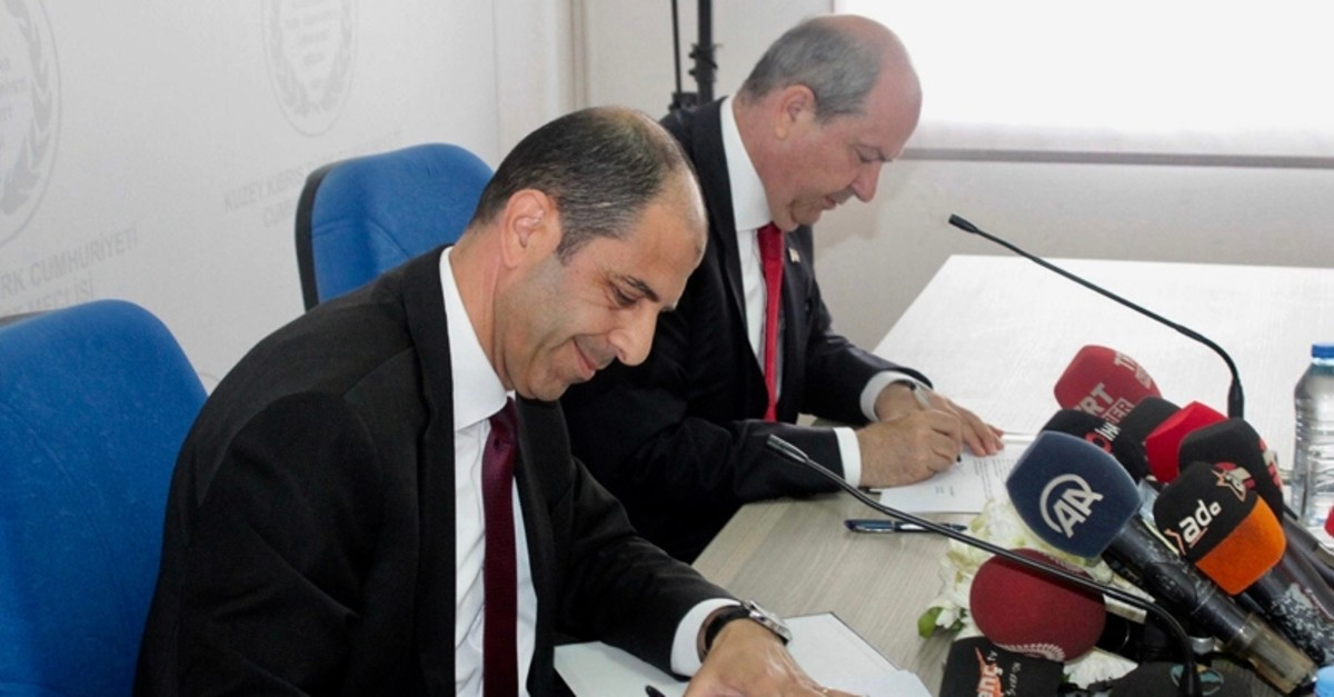 UBP leader and PM-designate Ersin Tatar (R) and HP leader Kudret u00d6zersay sign the coalition protocol at the TRNC Parliament in Nicosia, on May 22, 2019. (DHA Photo)