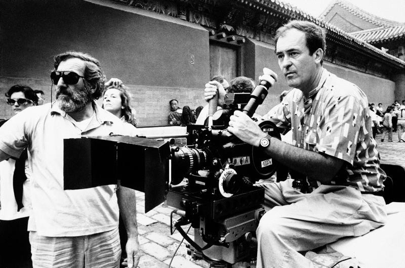 In this May 2, 1987 file photo Italian movie director Bernardo Bertolucci, right, checks a scene during the filming go the movie ,The Last Emperor,, in the Forbidden City of Beijing, China. (AP Photo)