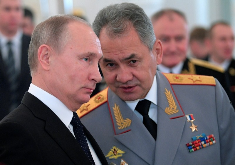 In this file photo taken on Thursday, Dec. 28, 2017, Russian President Vladimir Putin, left, and Defence Minister Sergei Shoigu talk during an awards ceremony for troops who fought in Syria, in the Kremlin, in Moscow, Russia. (AP Photo)