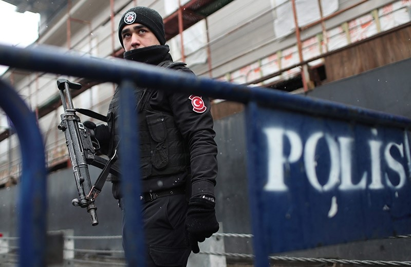 An armed Turkish riot policeman stands guard nearby the site following a gun attack on Reina, a popular night club in Istanbul near by the Bosphorus, in Istanbul, Turkey, 01 January 2017 morning. (EPA Photo)