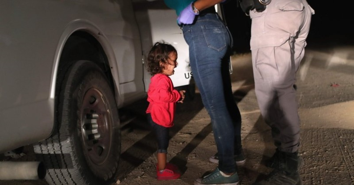 A 2-year-old Honduran asylum seeker cries as her mother is searched and detained near the U.S.-Mexico border in McAllen, Texas, June 12, 2018. (AFP Photo)