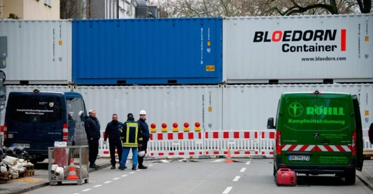 A road is blocked with containers in Dortmund, Germany, Sunday, Jan. 12, 2020. (dpa via AP)