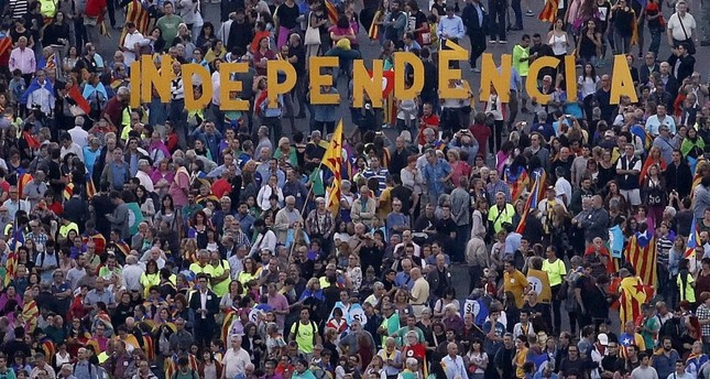 Catalans gather to call out to the Spanish government for their demand for independence.