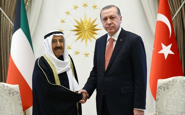 Kuwait's Emir Sheikh Sabah Al Ahmed Al Sabah, left, and President Recep Tayyip Erdoğan shake hands before a meeting in Ankara, Turkey, Tuesday, March 21, 2017.The Emir is in Turkey for a three-day official visit.