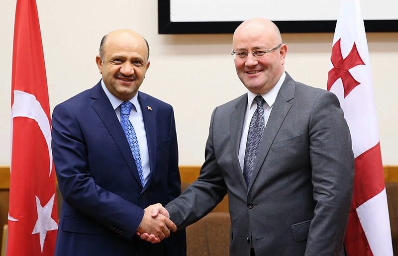 Defense Minister Fikri Iu015fu0131k (left) with Georgian counterpart Levan Izoria (AA File Photo)