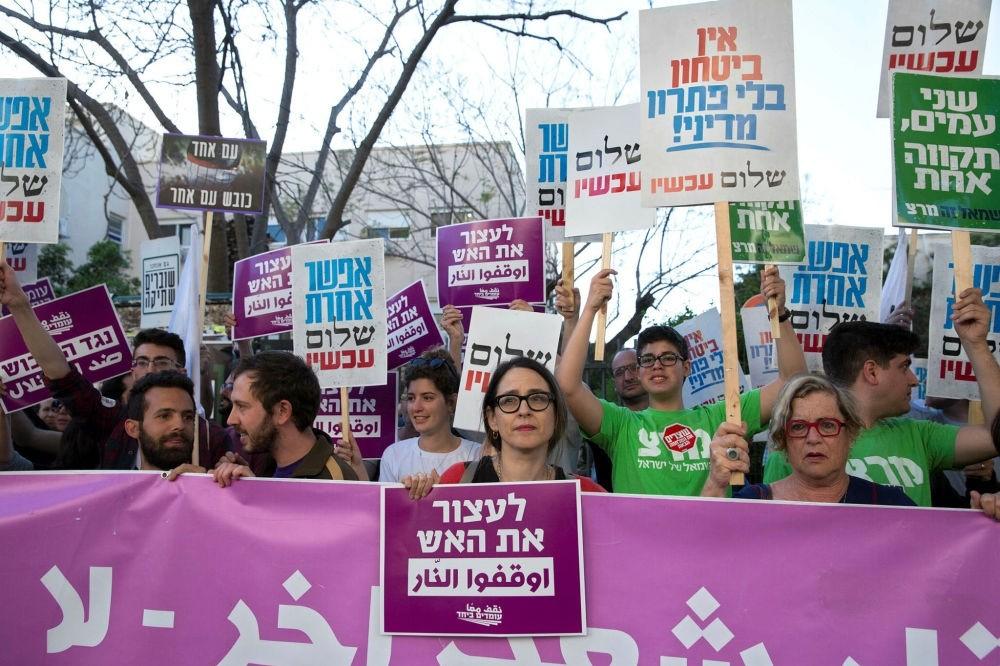 Israelis hold signs for Gaza while demonstrating, Tel Aviv, April 1.