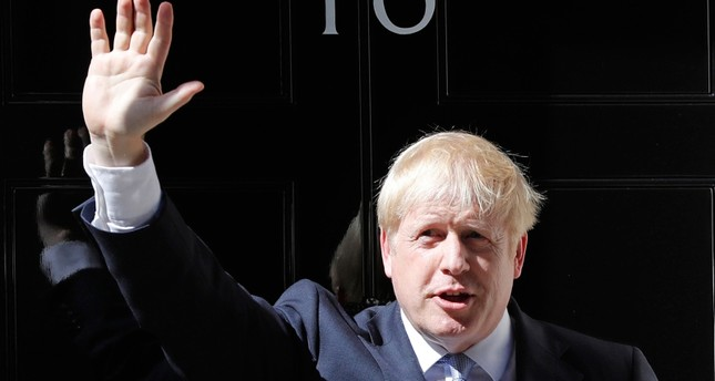 Britain's new Prime Minister Boris Johnson waves from the steps outside 10 Downing Street, London, Wednesday, July 24, 2019. AP Photo