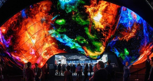 Attendees experience the LG OLED Wave made up of 200 55-inch LG OLED digital screens on the final day of CES in Las Vegas, Nevada, Jan. 10, 2020. AFP Photo