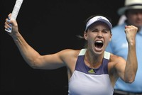 Emotional Wozniacki keeps final tournament dreams alive at Australian Open