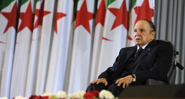 In this April 28, 2014 file photo, Algerian President Abdelaziz Bouteflika sits in a wheelchair after taking oath as President, in Algiers. (AP Photo)