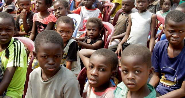 Congolese children gather at a soccer pitch as they await to be vaccinated. Reuters Photo