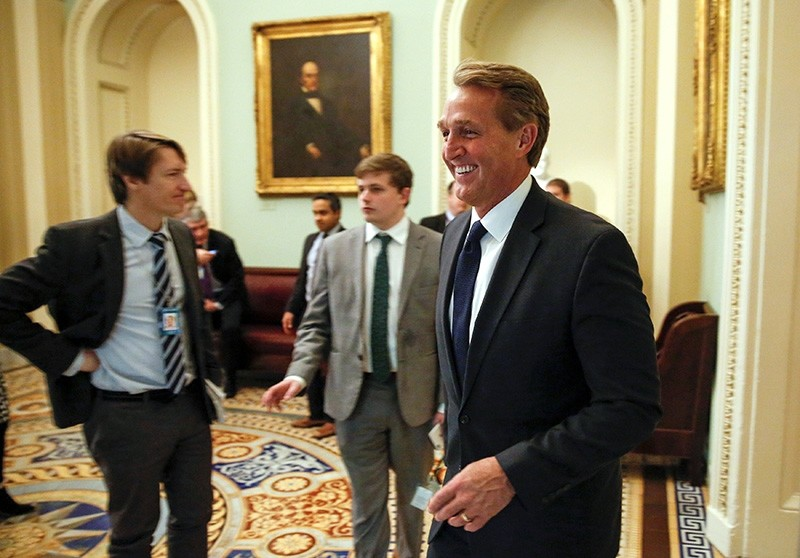Senator Jeff Flake (R-AZ) walks before a series of votes on legislation ending U.S. military support for the war in Yemen on Capitol Hill in Washington, U.S., Dec. 13, 2018. (Reuters Photo)