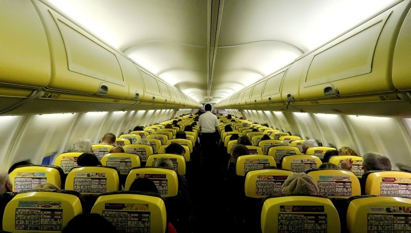 A cabin crew member serves passengers onboard a Ryanair passenger aircraft travelling from Madrid International Airport to Bergamo Airport, Italy, January 13, 2018. (REUTERS Photo)