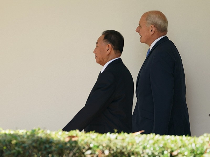 Chief of staff John Kelly walks along the Colonnade toward the Oval Office with Kim Yong Chol, former North Korean military intelligence chief and one of leader Kim Jong Un's closest aides, as he arrives at the White House on June 1, 2018. (AP Photo)