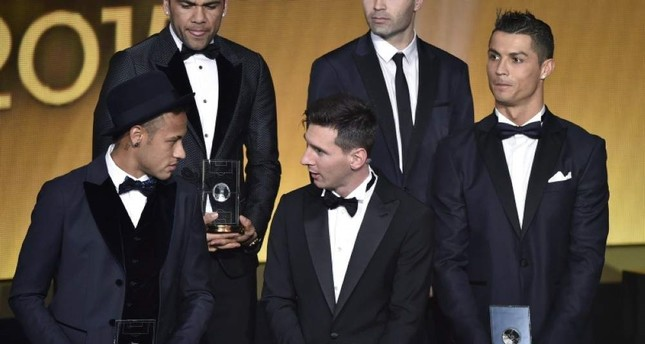 Neymar, Lionel Messi, and Portugal and Cristiano Ronaldo pose on stage after being selected in the 2015 FIFA FIFPro World XI during the 2015 FIFA Ballon d'Or award ceremony. (AFP Photo)