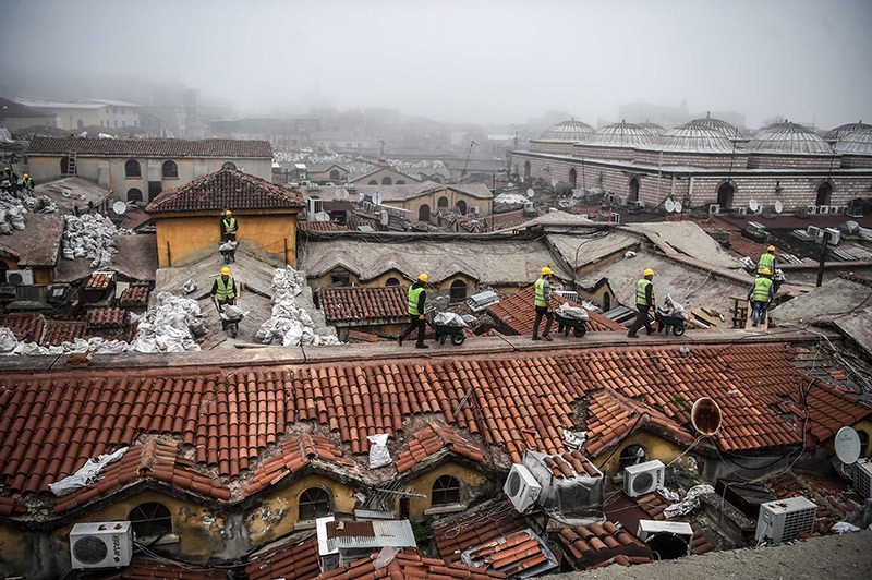 Workers pushing wheelbarrows on the top of Istanbul's iconic marketplace, the Grand Bazaar, during its renovation in Istanbul. (AFP Photo)