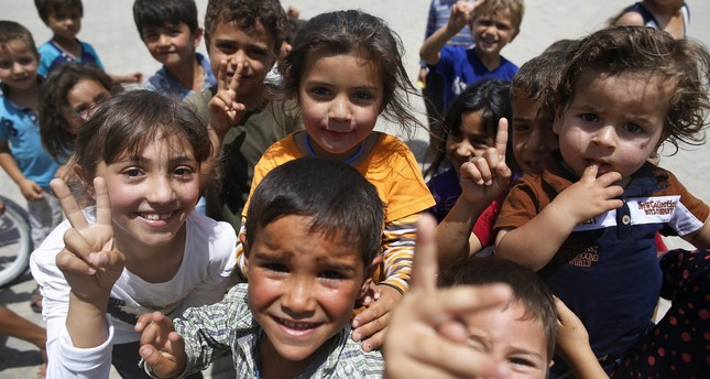 Children play at the Öncüpınar camp for Syrian refugees next to the border crossing with Syria, near Kilis in southeastern Turkey, June 20, 2016. (AP Photo)