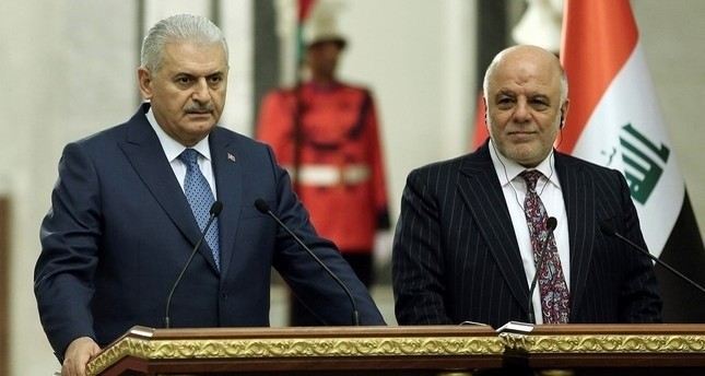 PM Yıldırım (L) and Iraqi counterpart Abadi.