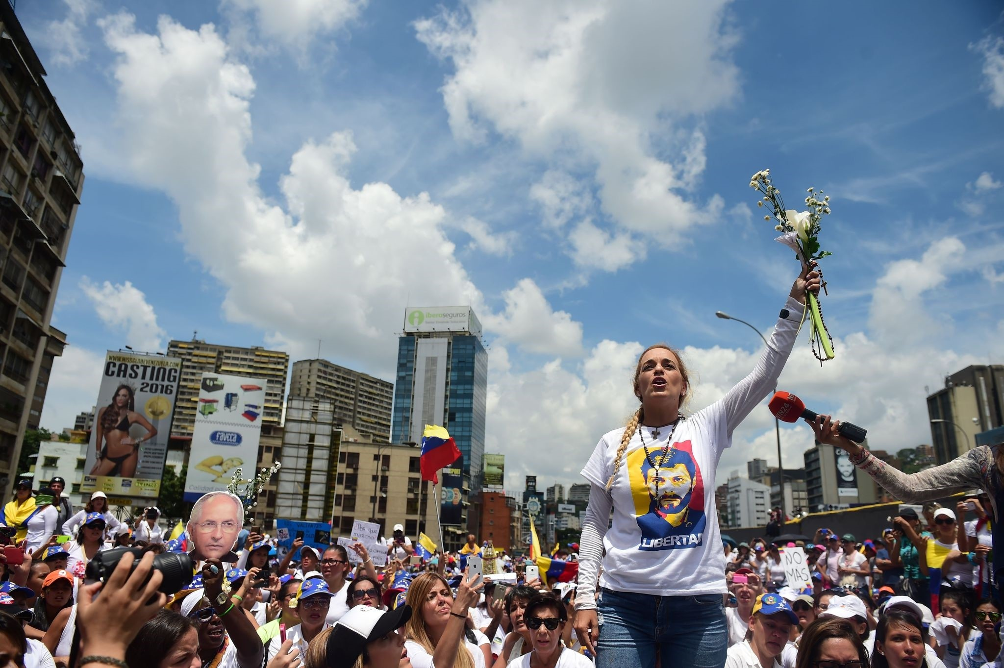 The wife of imprisoned opposition leader Leopoldo Lopez, Lilian Tintori, takes part in a women's march aimed to keep pressure on President Nicolas Maduro. (AFP Photo)