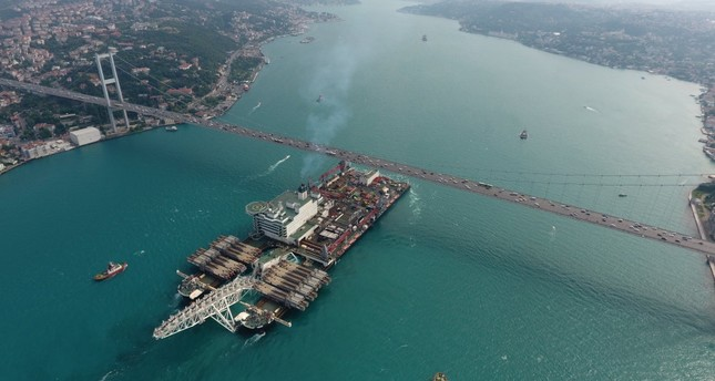 The Pioneering Spirit vessel, which completed the deep-water offshore construction of the TurkStream natural gas pipeline, passes through the Bosporus Strait under the iconic July 15 Martyrs' Bridge in Istanbul, June 24, 2017.